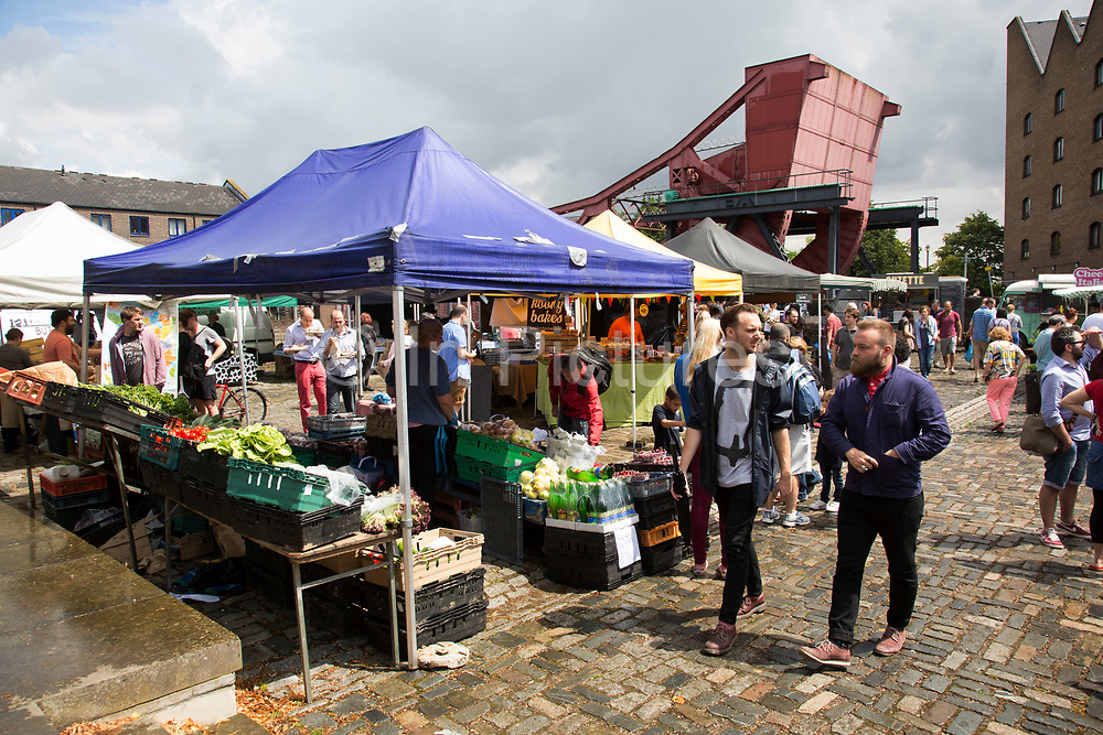 Wapping Market at Brussels Wharf in East London, UK. This weekly produce market gathers together some of the finest local farmers, producers and traders with stalls covering all locally sourced food, seasonal fruit and vegetables.