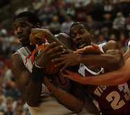 MORNING JOURNAL/DAVID RICHARD.Greg Oden battles for a rebound against Kammron Taylor, right, Sunday, Feb. 25, 2007, in Columbus, Ohio. Ohio State beat Wisconsin 49-48.