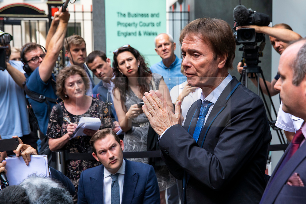 © Licensed to London News Pictures. 18/07/2018. London, UK. SIR CLIFF RICHARD (2-R) as he leaves the Rolls Building of the High Court in London after winning his claim for damages against the BBC for loss of earnings. The 77-year-old singer sued the corporation after his home in Sunningdale, Berkshire was raided following allegations of sexual assault made to Metropolitan Police. Photo credit: Rob Pinney/LNP