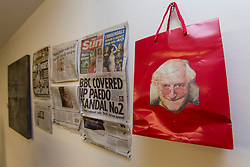 © licensed to London News Pictures. London, UK 24/10/2012. A picture of Jimmy Savile put on plastic bag next to newspaper cuttings at 'Jimmy Savile is innocent' exhibition at Bread and Butter Gallery in Islington. Photo credit: Tolga Akmen/LNP