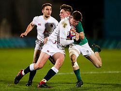 Freddie Steward of England U20 is tackled by Ethan McIlroy of Ireland U20 - Rogan/JMP - 21/02/2020 - Franklin's Gardens - Northampton, England - England U20 v Ireland U20 - Under 20 Six Nations.