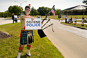"08 AUGUST 2020 - WEST DES MOINES, IOWA: People line Mills Civic Parkway in front of the West Des Moines police station during a rally in support of police and law enforcement. About 100 people gathered at the West Des Moines Law Enforcement Center to rally in support of law enforcement. The rally was organized by ""Uplifting Our Police,"" a local organization that supports law enforcement. They rallied at Des Moines Police headquarters in July. They are planning similar rallies at police stations in the Des Moines metropolitan area.     PHOTO BY JACK KURTZ"