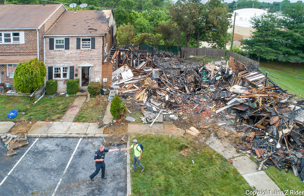 Aerial view of three row homes destroyed in the blast and resulting fire.
