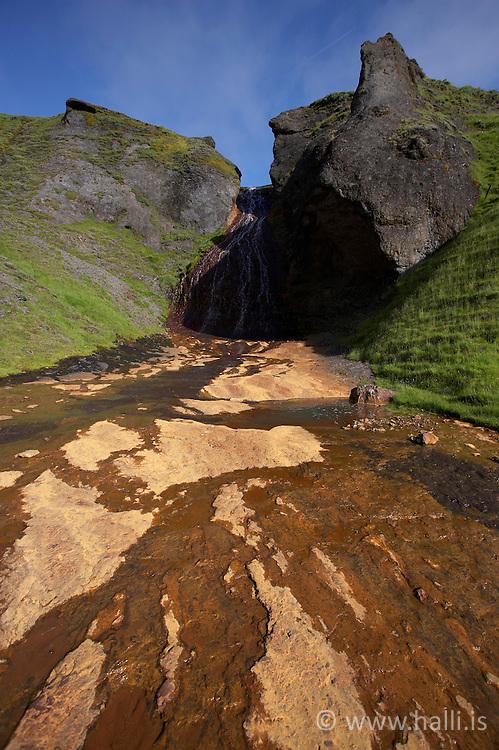 Small waterfall near Systrastapi in Kirkjubaejarklaustur on the south coast of Iceland - Lítill foss við Systrastapa á Kirkjubæjarklaustri