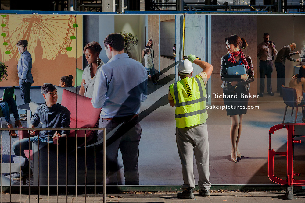 Contractors erect a new regeneration project hoarding at Elephant Park, at Elephant & Castle, London borough of Southwark. Southwark Council's development partner, Lendlease is regenerating over 28 acres across three sites at the heart of Elephant & Castle, in what is the latest major regeneration opportunity in zone 1 London. The vision for the £1.5 billion regeneration is to build on the area's strengths and vibrant character in order to re-establish Elephant & Castle as one of London's most flourishing urban quarters. The Elephant & Castle regeneration is of a scale rarely seen in central London and includes almost 3,000 new homes, plus office, retail, community, leisure and restaurant space.