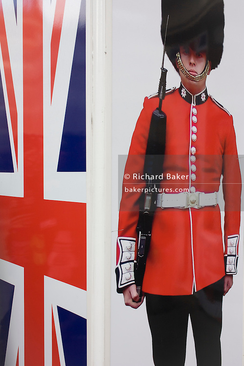 Coldstream guardsman and Union Jack flag appear on a poster outside a tourit shop in central London.