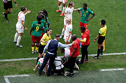 Match referee Qin Liang intervenes after Cameroon's Alexandra Takounda (21) fouls England's Steph Houghton (obscured) and England head coach Phil Neville (bottom left) and Cameroon head coach Alain Djeumfa (bottom right) exchange words during the FIFA Women's World Cup, round of Sixteen match at State du Hainaut, Valenciennes.