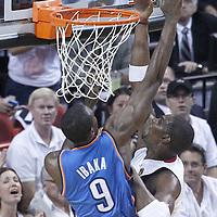 21 June 2012: Miami Heat power forward Chris Bosh (1) goes for the layup past Oklahoma City Thunder power forward Serge Ibaka (9) during the Miami Heat 121-106 victory over the Oklahoma City Thunder, in Game 5 of the 2012 NBA Finals, at the AmericanAirlinesArena, Miami, Florida, USA. The Miami Heat wins the series 4-1.