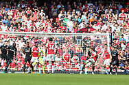Arsenal defender Nacho Monreal (18) scores a goal to make it 1-0 during the Premier League match between Arsenal and West Ham United at the Emirates Stadium, London, England on 22 April 2018. Picture by Bennett Dean.