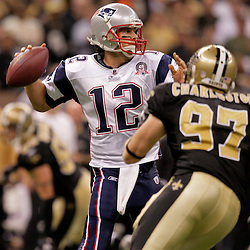 2009 November 30:  New Orleans Saints defensive end Jeff Charleston (97) pressures New England Patriots quarterback Tom Brady (12) during a 38-17 win by the New Orleans Saints over the New England Patriots at the Louisiana Superdome in New Orleans, Louisiana.