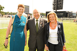 Left to right, MR & MRS URS SCHWARZENBACH and ROS PACKER at the Cartier International Polo at Guards Polo Club, Windsor Great Park, Berkshire on 25th July 2010.