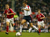Photograph: Scott Heavey.<br />England v Denmark. International Friendly. 16/11/2003.<br />Joe Cole bursts through the Danish defence
