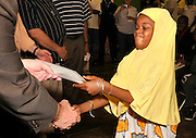 A young girl receives her citizenship papers at the Tucson World Refugee Fest 2012, Tucson, Arizona, USA.