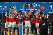 the Arsenal Under 21 team celebrate as they lift  the Barclays Under 21 Premier League Division 2 play off trophy. U21 Barclays Premier league play off final match, Arsenal U21's v Aston Villa U21's at the Emirates Stadium in London on Tuesday 10th May 2016.<br /> pic by Steffan Bowen, Andrew Orchard sports photography.