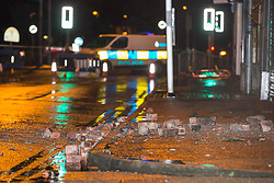 © Licensed to London News Pictures . 15/01/2015 . Middleton , UK . Bricks landed in the road as high winds blow out the gable end of a building on Market Place , Middleton , closing the road, as heavy rain and winds cause disruption across the UK .  Photo credit : Joel Goodman/LNP