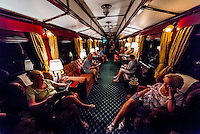 "Passengers sitting in the observation car, Rovos Rail train  ""Pride of Africa"" between Pretoria and Cape Town, South Africa."