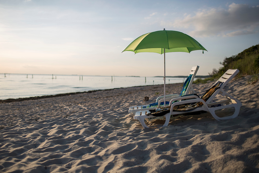 CAPE CHARLES, VA - JUNE 20: Beach chairs and an umbrella are pictured at Sunset Beach on Friday, June 20th, 2014 near Cape Charles, Va. (Photo by Jay Westcott/For The Washington Post)