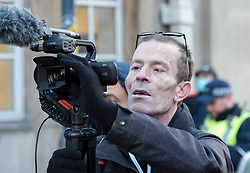 © Licensed to London News Pictures;03/07/2021; Bristol, UK. File Picture dated 26/03/2021 of CHRISTOPHER BATT from Bristol who livestreams as Tyrant Finder UK, filming at the third Kill the Bill protest in Bristol against the Police, Crime, Sentencing and Courts Bill during the Covid-19 coronavirus pandemic in England. Christopher Batt is due at Westminster Magistrates Court on Saturday 03 July 2021 for non-payment of a fine he received for breaching covid lockdown laws after he was arrested in the Oxford Street area of London on 05 November 2020. He is a father-of-six from the Hartcliffe area of Bristol and livestreams anti-lockdown protests and police activity in Bristol and around the country on his YouTube 'Tyrant Finder UK' channel. He has asked for people to attend outside the court to support him and has appealed for legal advice and for others to livestream the event. Photo credit: Simon Chapman/LNP.