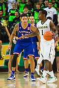 WACO, TX - JANUARY 7: Kelly Oubre Jr. #12 of the Kansas Jayhawks defends against Kenny Chery #1 of the Baylor Bears on January 7, 2015 at the Ferrell Center in Waco, Texas.  (Photo by Cooper Neill/Getty Images) *** Local Caption *** Kelly Oubre Jr.