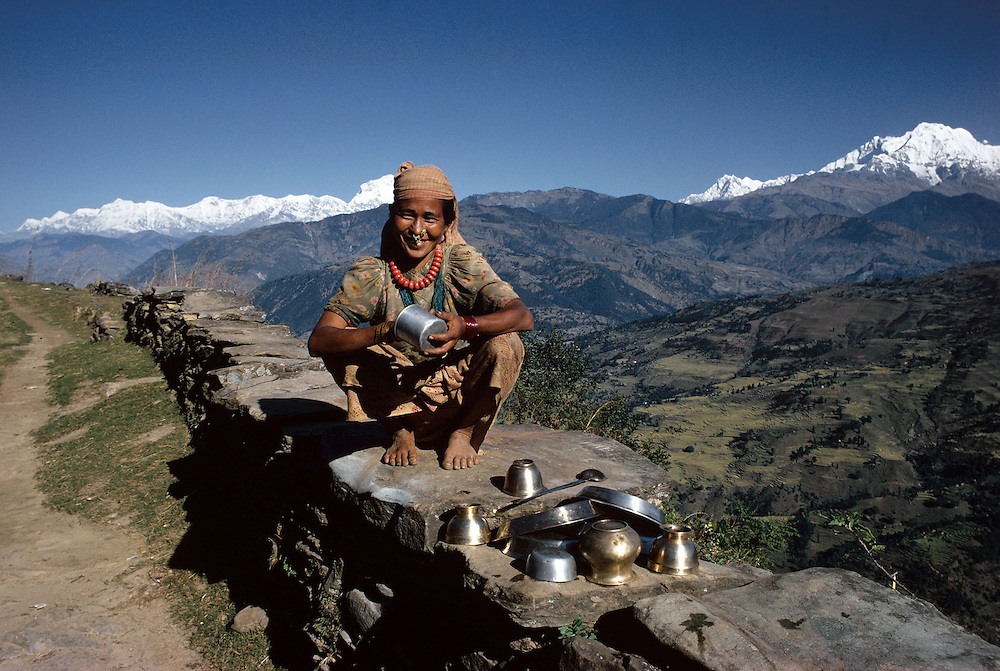 Gurkha woman seen with the Himalayan mountain range behind her. Photographed by Terry Fincher. 1969