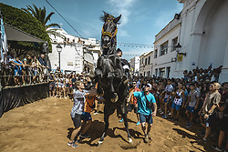 August 27, 2017 - Sant Lluis, Balearic Islands, Spain - A 'caixer' (horse rider) rears up on his horse in between the cheering crowd during the 'Jaleo' of the annual festival in Sant LLuis, the town's patron saint fiesta (Credit Image: © Matthias Oesterle via ZUMA Wire)
