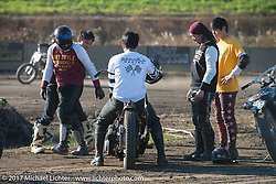 Go Takamine checking out the damage after a crash at his Brat Style's flat track racing at West Point Offroad Village. Kawagoe, Saitama. Japan. Wednesday December 6, 2017. Photography ©2017 Michael Lichter.