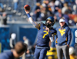 Nov 10, 2018; Morgantown, WV, USA; West Virginia Mountaineers quarterback Will Grier (7) warms up before their game against the TCU Horned Frogs at Mountaineer Field at Milan Puskar Stadium. Mandatory Credit: Ben Queen-USA TODAY Sports
