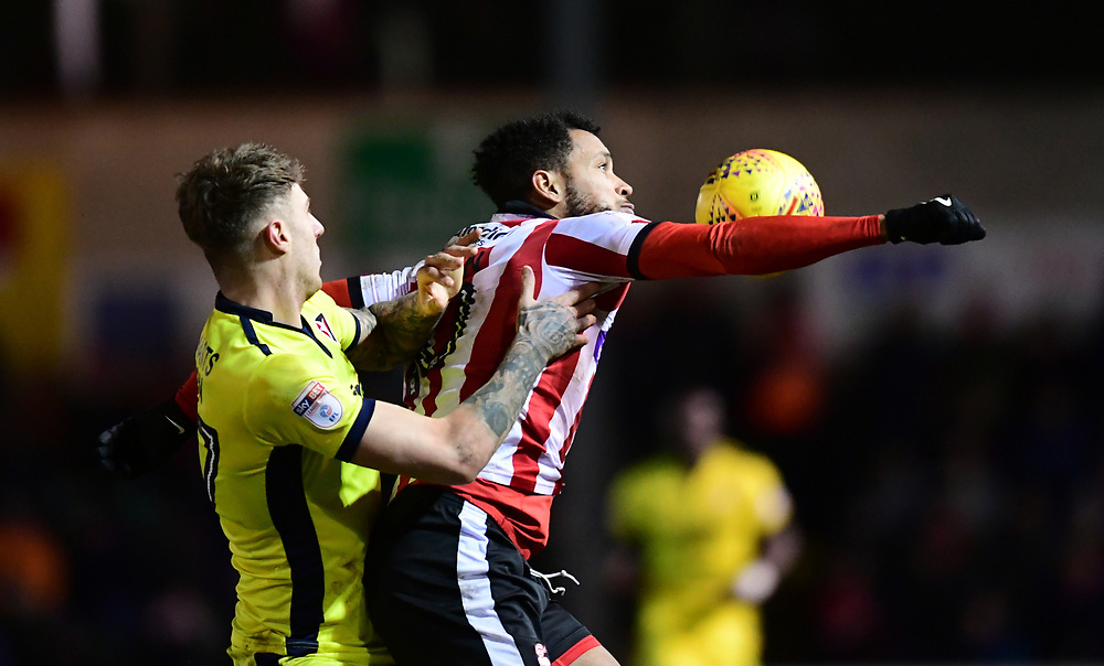 Lincoln City's Matt Green shields the ball from Cheltenham Town's Joe Rodon<br /> <br /> Photographer Chris Vaughan/CameraSport<br /> <br /> The EFL Sky Bet League Two - Lincoln City v Cheltenham Town - Tuesday 13th February 2018 - Sincil Bank - Lincoln<br /> <br /> World Copyright © 2018 CameraSport. All rights reserved. 43 Linden Ave. Countesthorpe. Leicester. England. LE8 5PG - Tel: +44 (0) 116 277 4147 - admin@camerasport.com - www.camerasport.com