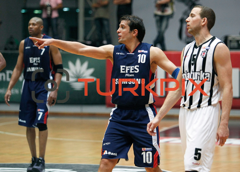 Besiktas's Muratcan GULER (R) and Efes Pilsen's Kerem TUNCERI (C), Charles SMITH (L) during their Turkish Basketball league Play Off semi final second leg match Besiktas between Efes Pilsen at the BJK Akatlar Arena in Istanbul Turkey on Wednesday 12 May 2010. Photo by Aykut AKICI/TURKPIX