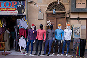 Mannequins in outside a clothing business displaying the latest western-style clothes for males in modern Luxor, Nile Valley, Egypt.
