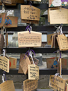 close up of prayer tablets outside an Asian temple Japan