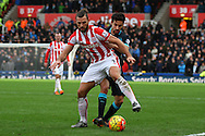 Eric Pieters of Stoke City shields the ball from Jesus Navas of Manchester City. Barclays Premier league match, Stoke city v Manchester city at the Britannia Stadium in Stoke on Trent, Staffs on Saturday 5th December 2015.<br /> pic by Chris Stading, Andrew Orchard sports photography.