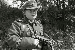 Young Reenactor portraying a member of 1 Kompanie Gro§deutschland on gate duty at Fort Paull<br /> <br />   04May 2015<br />   Image © Paul David Drabble <br />   www.pauldaviddrabble.co.uk