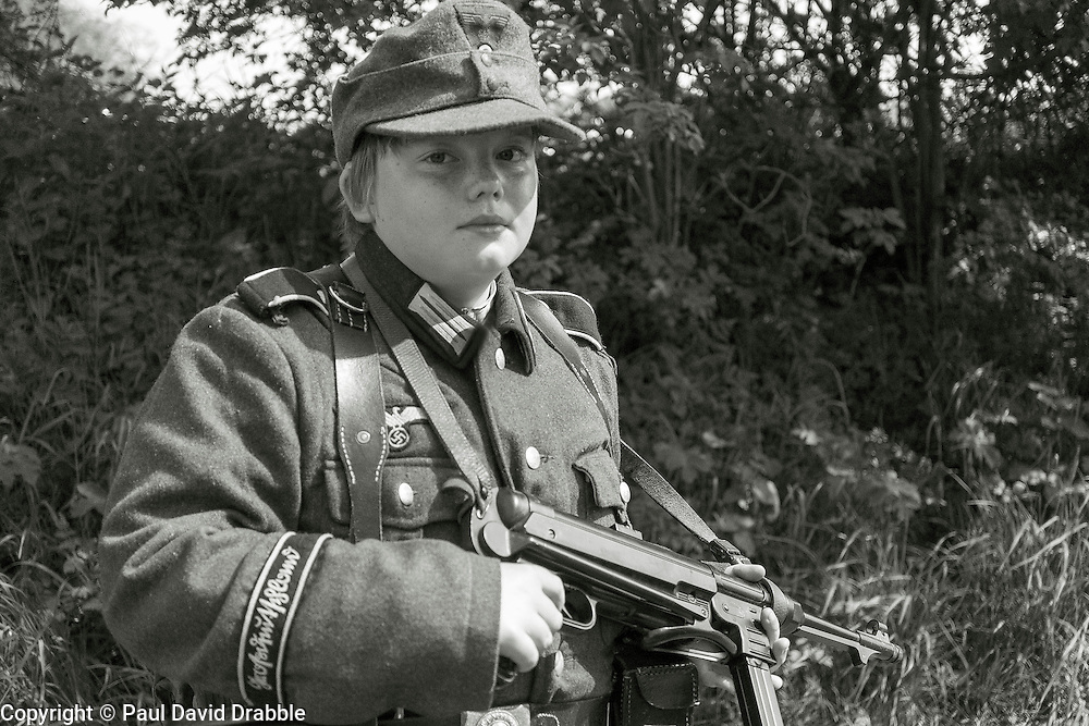 Young Reenactor portraying a member of 1 Kompanie Gro§deutschland on gate duty at Fort Paull<br /> <br />   04May 2015<br />   Image © Paul David Drabble <br />   www.pauldaviddrabble.co.uk