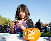 Vanessa Gonzalez, 6, of Milpitas decorates a pumpkin during the annual Sunnyhills Neighborhood Association's Sunnyhills Pre-Halloween Party at Albert Augustine Jr. Memorial Park in Milpitas, California, on October 26, 2013. (Stan Olszewski/SOSKIphoto)