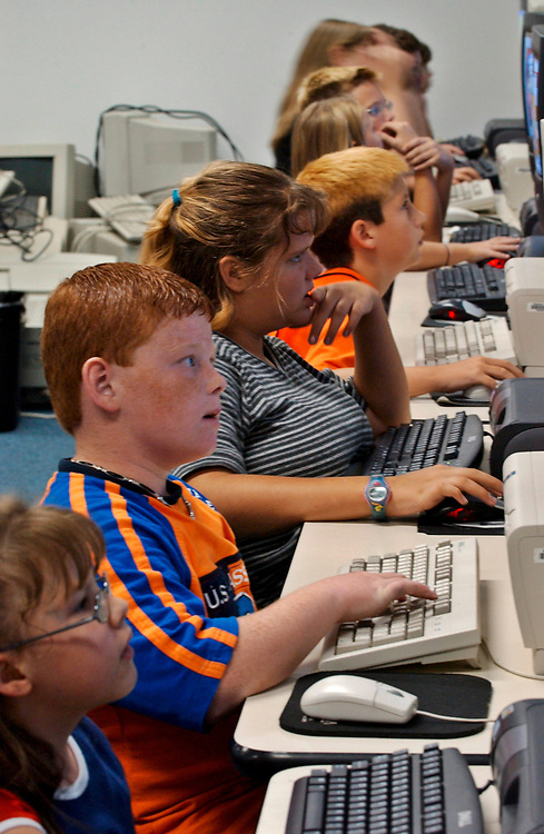 Gun Barrel City, Texas September 9, 2003:   Education at Lakeview and Southside Elementary Schools in the Mabank Independent School Discrict in northeast Texas. <br /> 4th and 5th graders at PC computer lab at Southside Elementary, working on math and reading software programs during scheduled computer time.  <br /> ©Bob Daemmrich