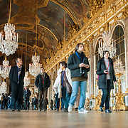 Tourists visit the Hall of Mirrors at Palace of Versailles, France.
