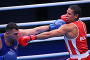 Victor Schelstraete of Belgium,(right) and Ahmed Hagag of Austria compete in the Men's Heavyweight preliminaries