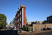 Man sunning himself during lockdown in Thurloe Square, Kensington, deserted during the Coronavirus pandemic on 23th April 2020 in London, United Kingdom. The government clampdown includes the closure of most shops, bars and theatres throughout the country. <br /> No.5 Thurloe Square, nicknamed 'the Thin House', is thought to be one of the narrowest homes in the capital.  At its narrowest point, the building is said to be 6ft wide, spanning to 34ft at its largest. The large north-facing windows are perfect for letting in lots of light for the artists to work in.