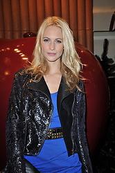 POPPY DELEVINGNE at a party to celebrate the launch of the new Mulberry leather case for Apple's iPhone held at the Mulberry store, Bond Street, London on 5th November 2009.