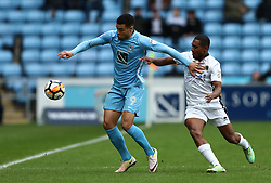 Coventry City's Maxime Biamoun (left) and Boredom Wood's Ricky Shakes battle for the ball
