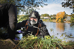 © Licensed to London News Pictures. 19/10/2016. Oxshott, UK. A member of a specialist dive team enters the water as he searches Littleheath Pond near Oxshott, Surrey in connection with the murder of 50-year-old Robyn Mercer. The body of Mother-of-two, Robyn Mercer was discovered outside a residential address in West Molesey in March.  Photo credit: Peter Macdiarmid/LNP