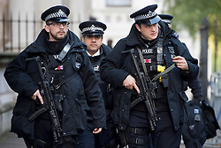 Armed police arrive in Downing Street for the annual Remembrance Sunday Service at the Cenotaph memorial in Whitehall, central London, held in tribute for members of the armed forces who have died in major conflicts.