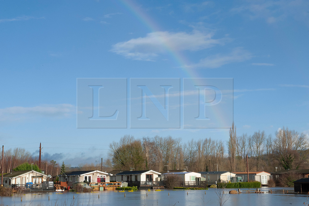 ©Licensed to London News Pictures 21/12/2019. <br /> Yalding ,UK.  A rainbow above Little Venice Country Park and Marina in Yalding which has been severely flooded, residents of the lodge and caravan community are having to use boats to get on and off the site. The River Medway in Yalding, Kent has bursts its banks causing severe flooding to the village.   Photo credit: Grant Falvey/LNP