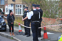 © Licensed to London News Pictures.10/04/2018<br /> HITHER GREEN, UK.<br /> Family and friends of Henry Vincent arrive to hang up the ripped down flowers ..One of the woman talking to police .<br />  Hither Green Burglary Murder. South Park Crescent,Hither Green.<br /> Family and friends of Henry Vincent arrive to hang up the ripped down flowers  outside the home of 78 year old Richard Osborn-Brooks who stabbed a burglar to death in his home.<br /> Photo credit: Grant Falvey/LNP