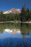 Mount Gibbs reflected in alpine lake water near Tioga Pass, Yosemite National Park, California