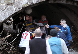 The ball ends up in the River Dove - Mandatory byline: Robbie Stephenson/JMP - 09/02/2016 - FOOTBALL -  - Ashbourne, England - Up'Ards v Down'Ards - Royal Shrovetide Football