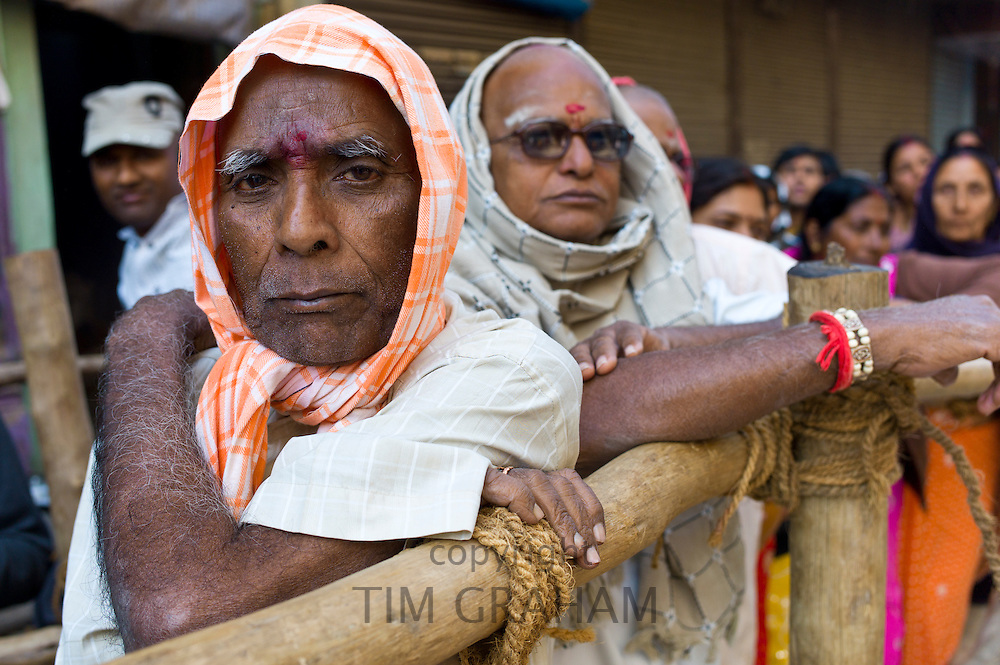 Indian Hindu pilgrims queue to visit the Golden Temple during Festival of Shivaratri in holy city of Varanasi, Northern India