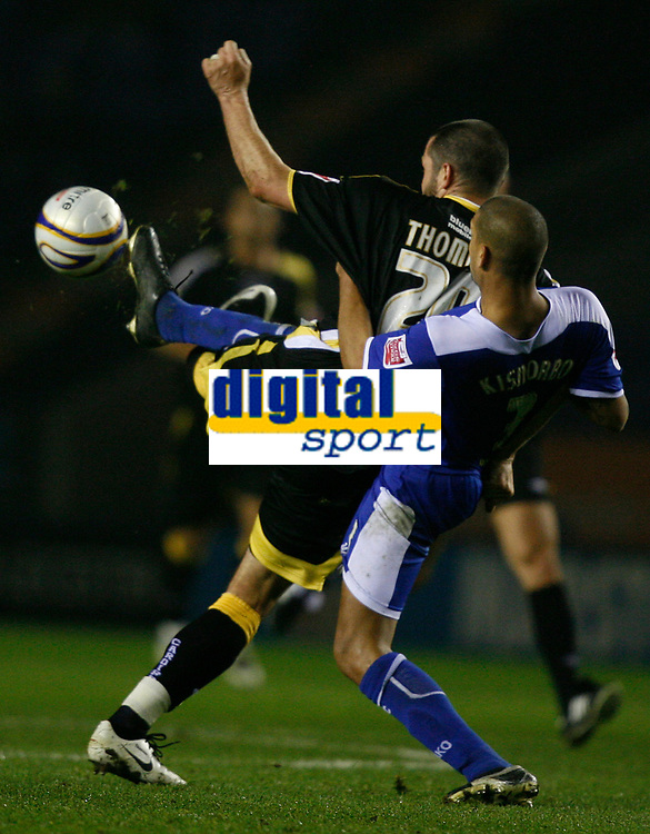 Photo: Steve Bond.<br />Leicester City v Cardiff City. Coca Cola Championship. 26/11/2007. Steve Thompson (L) in a tangle with Patrick Kisnorbo (R)