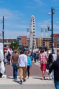 People gather along the riverfront at Cincinnati's Asian American Food Festival; May, 2019; Cincinnati, Ohio, USA.